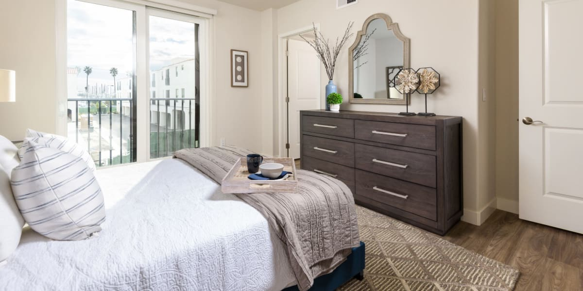 Master bedroom with balcony at Portside Ventura Harbor in Ventura, California