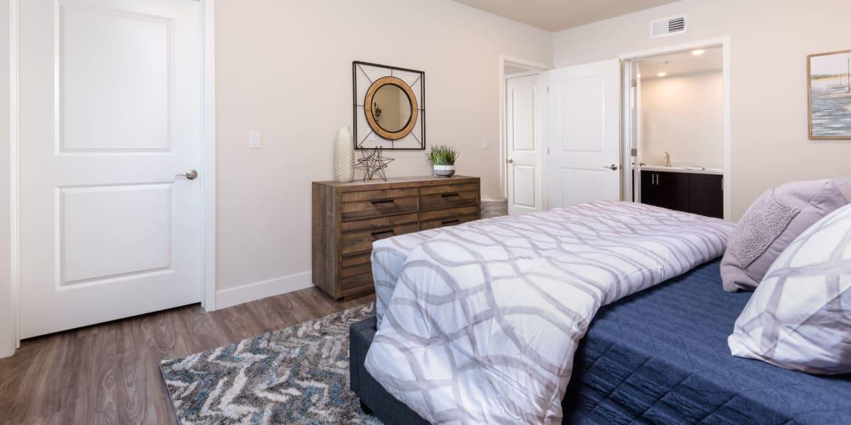 Cozy bedroom with hardwood flooring at Portside Ventura Harbor in Ventura, California