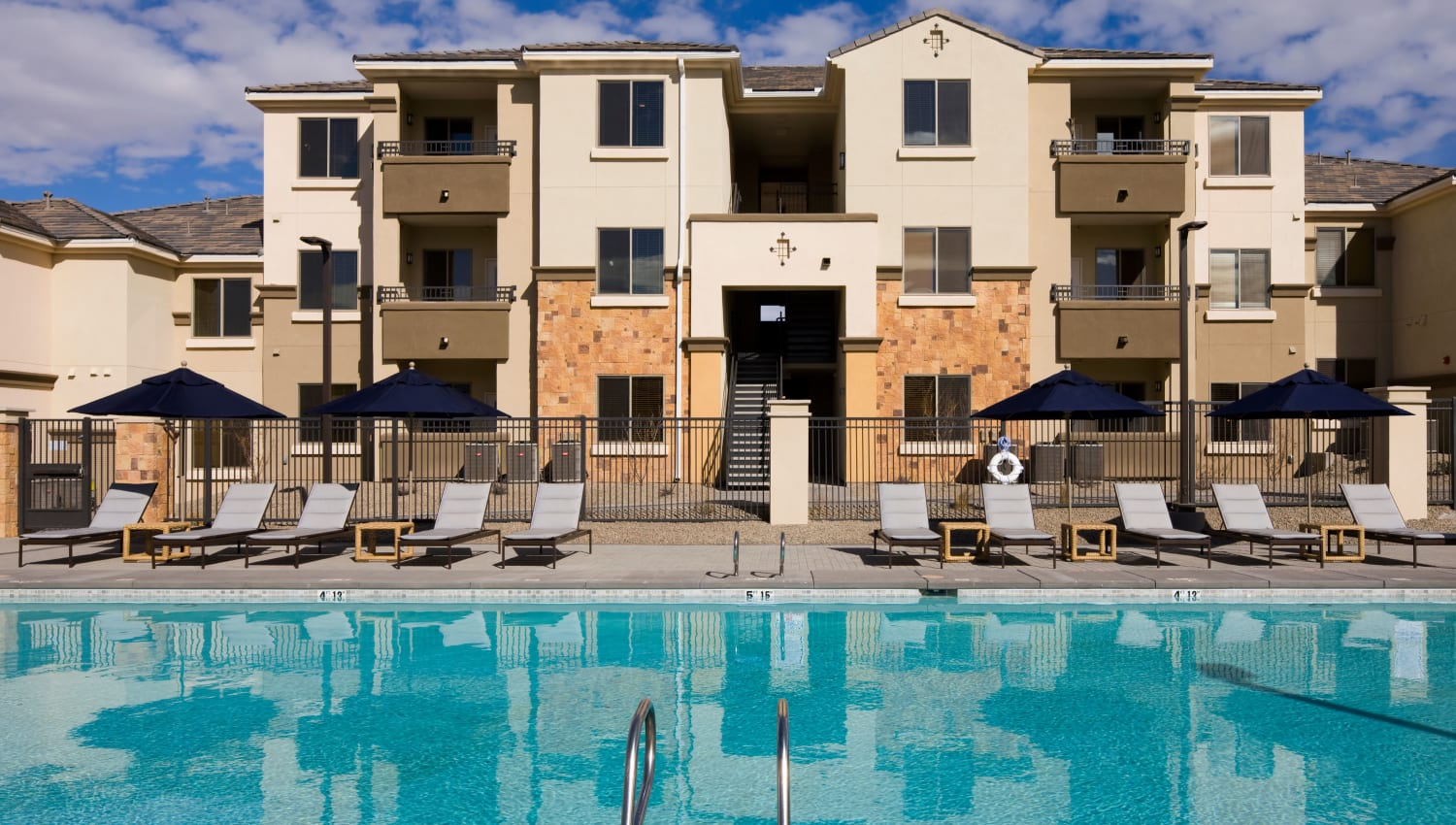 Exterior view of our luxury swimming pool at Olympus Alameda in Albuquerque, New Mexico