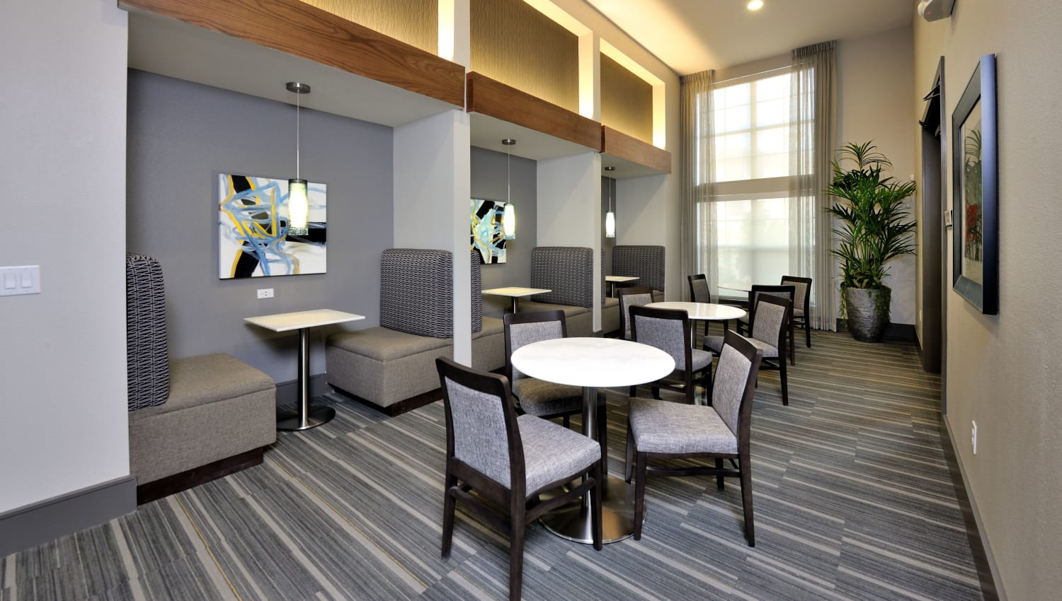 Meeting room with small booths at Olympus Falcon Landing in Katy, Texas