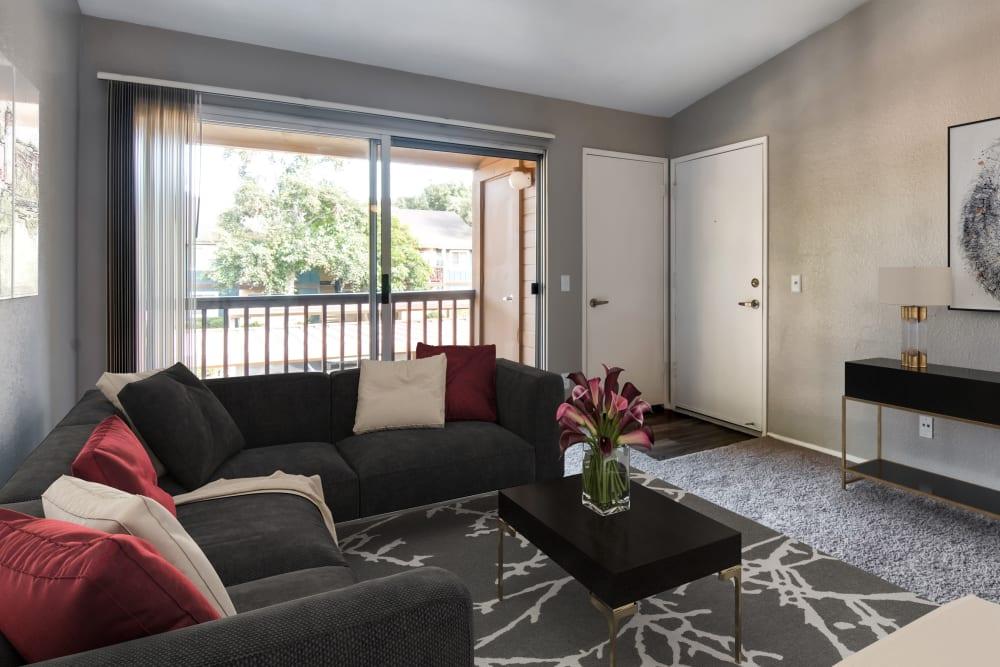 A living room complete with a private patio at Terra Nova Villas in Chula Vista, California