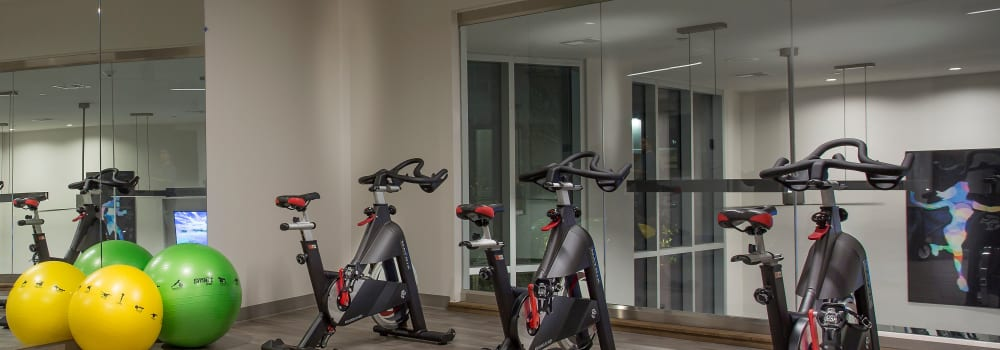 A fitness center with spin bikes at Greenhouse in Houston, Texas