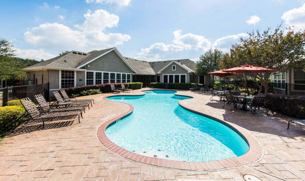 Resort-style swimming pool at Marquis at Stone Oak apartments for rent in San Antonio, TX