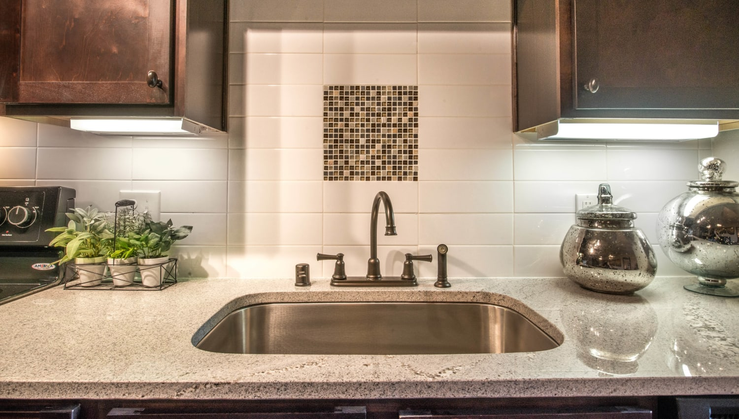 Custom tile backsplash in a model home's kitchen at Union At Carrollton Square in Carrollton, Texas