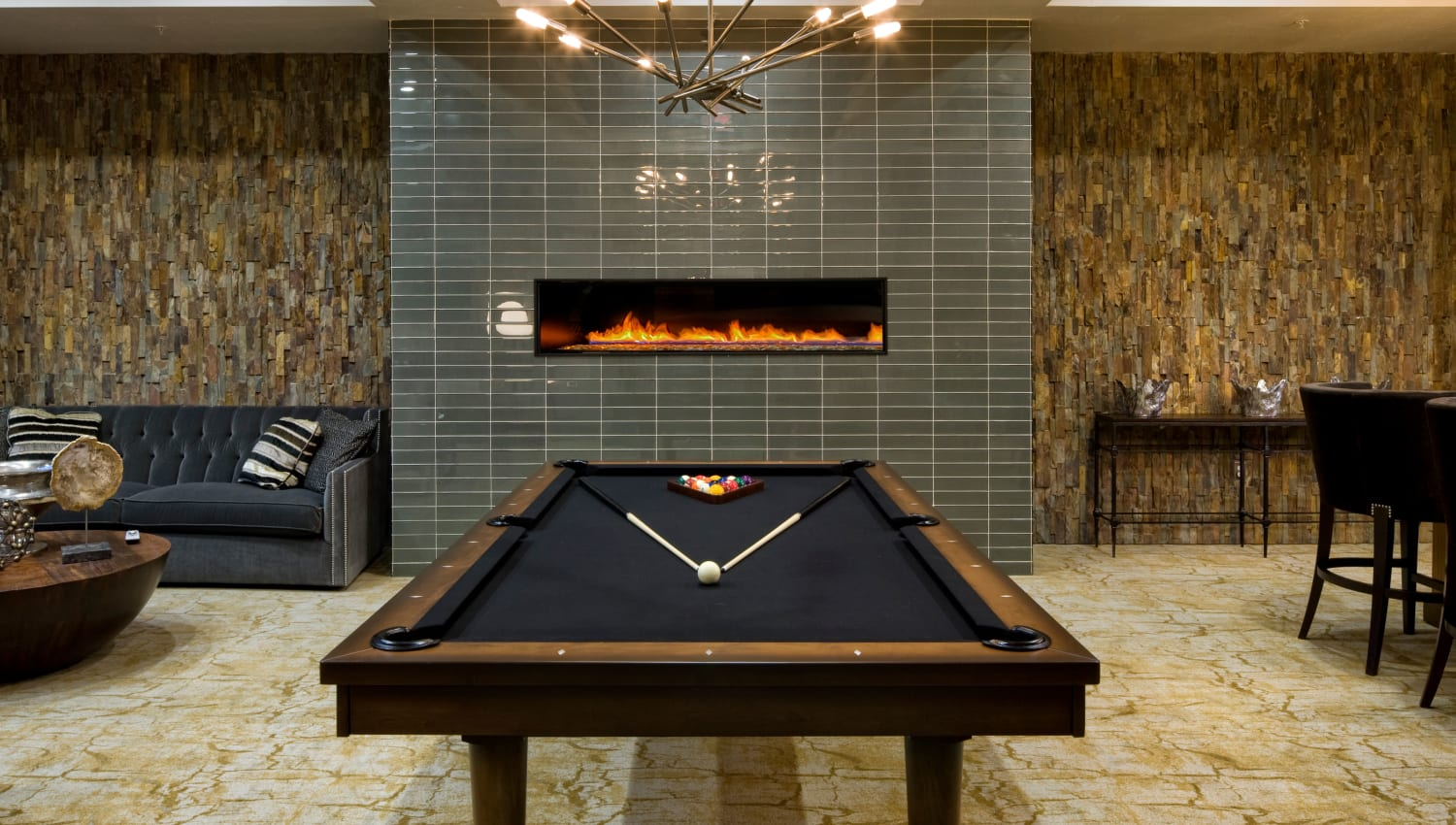 Pool table and fireplace at Olympus Alameda in Albuquerque, New Mexico