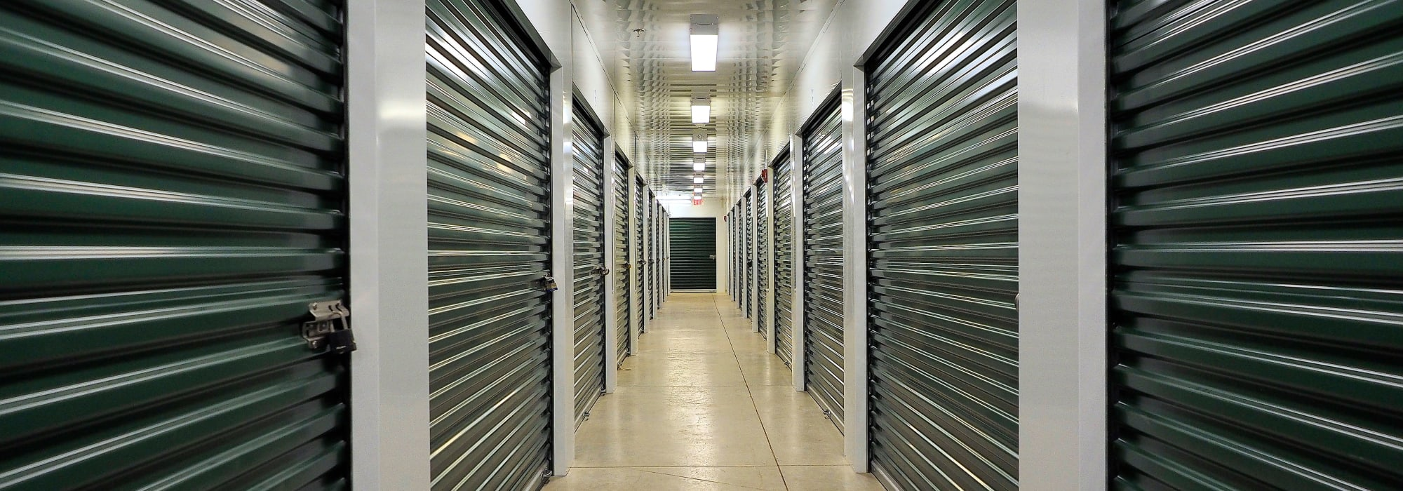 Apple Self Storage - Collingwood in Collingwood, Ontario, interior units with green doors