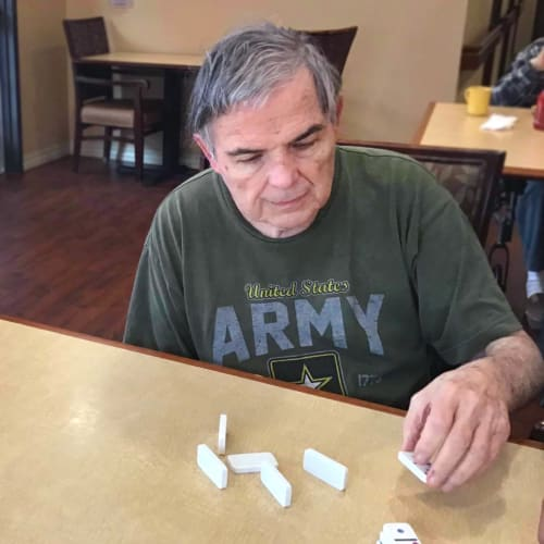 Resident matching dominos Oxford Glen Memory Care at Grand Prairie in Grand Prairie, Texas