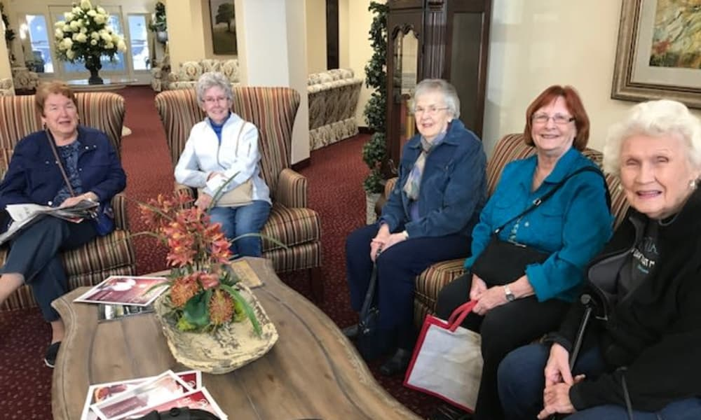 Group of residents posing for a photo at Ashton Gardens Gracious Retirement Living in Portland, Maine