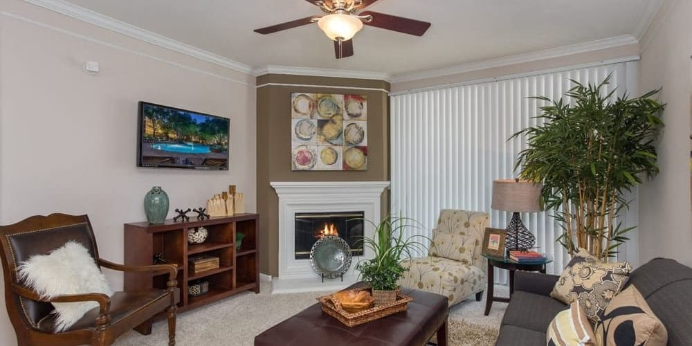 Well-lit and spacious living room at The Verandas at Timberglen in Dallas, Texas