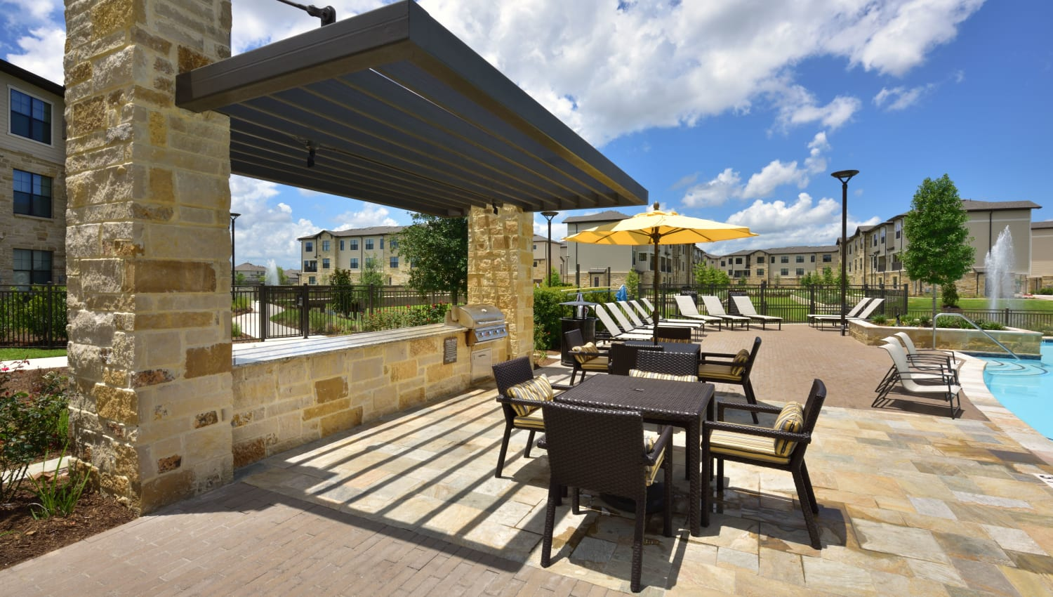 Poolside seating at Olympus Falcon Landing in Katy, Texas