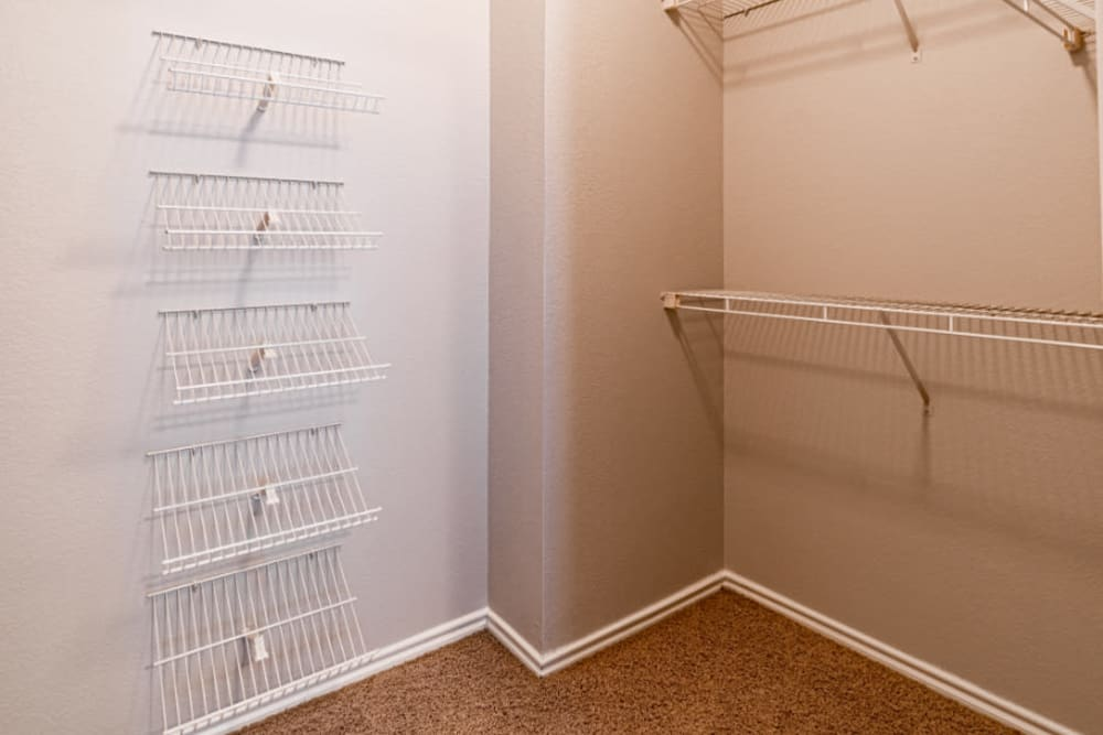 Walk-in closet with closet organizers at Marquis at Lantana in Flower Mound, Texas