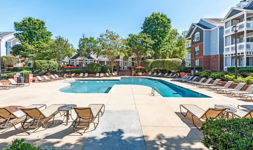 Resort-style swimming pool at The Village Apartments apartments for rent in Raleigh, NC
