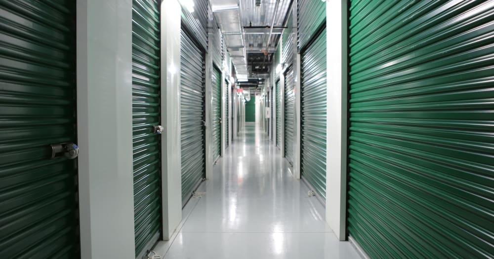 Storage units with green doors at Midgard Self Storage in Bradenton, Florida