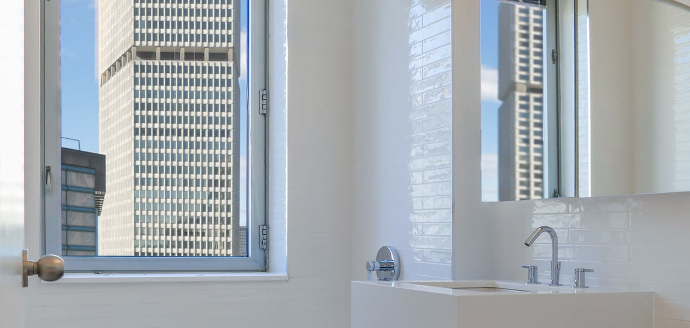 A bathroom with a large window at The Metropolis in New York, New York