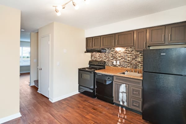 Kitchen with black appliances at The Hills at Oakwood Apartment Homes in Chattanooga, Tennessee