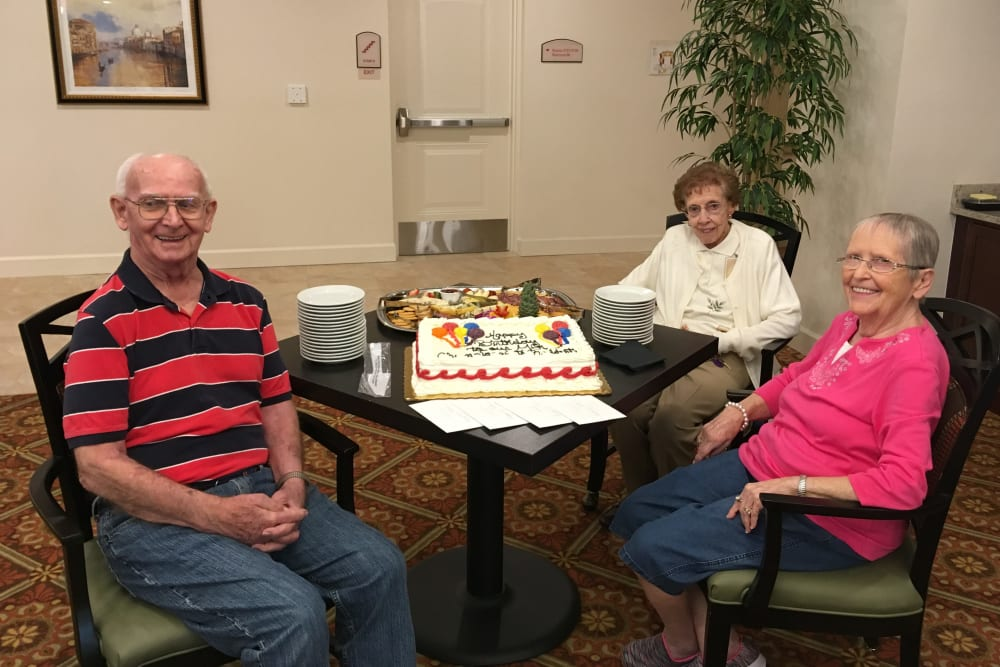 Residents enjoying a birthday party at  Merrill Gardens at ChampionsGate in ChampionsGate, Florida.