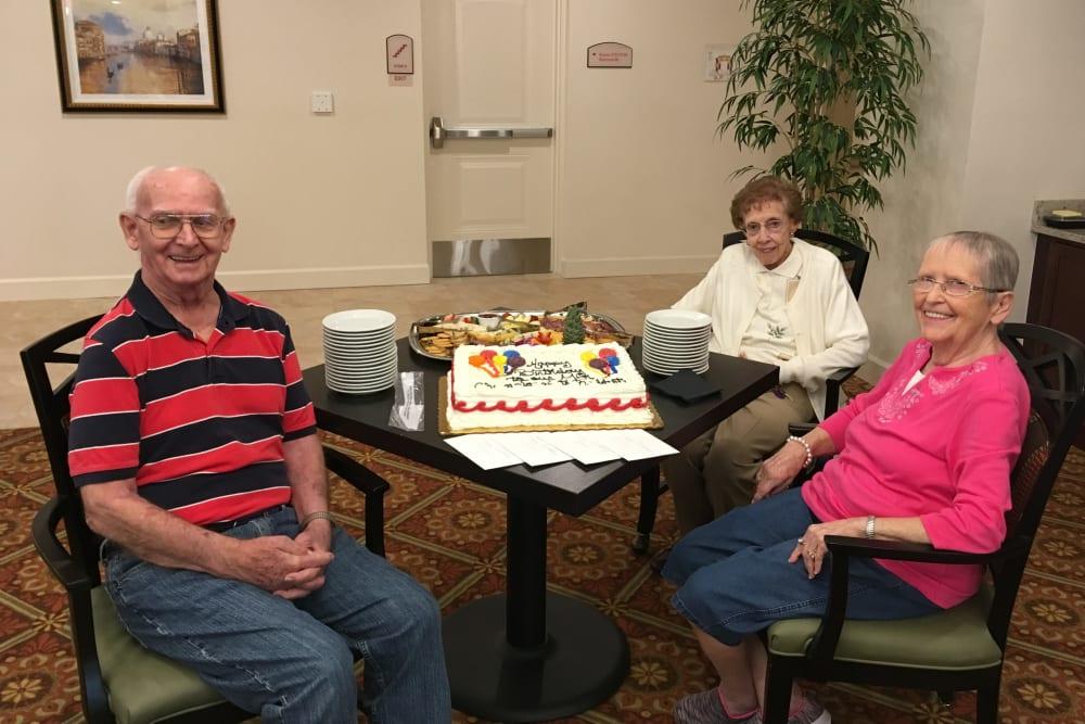 Residents enjoying a birthday party at Merrill Gardens at ChampionsGate