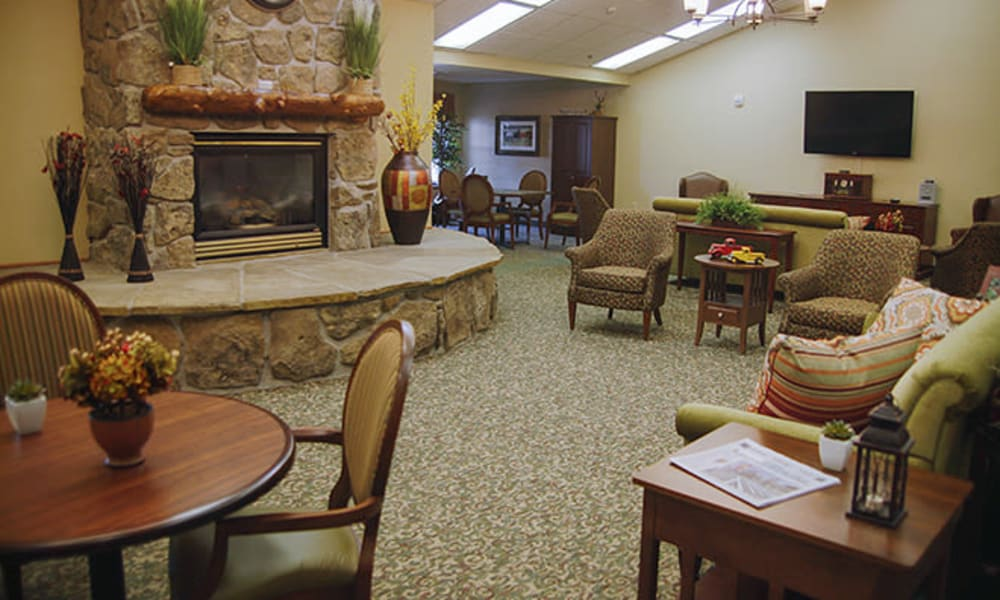Community common space with stone fireplace at Absaroka Senior Living in Cody, Wyoming
