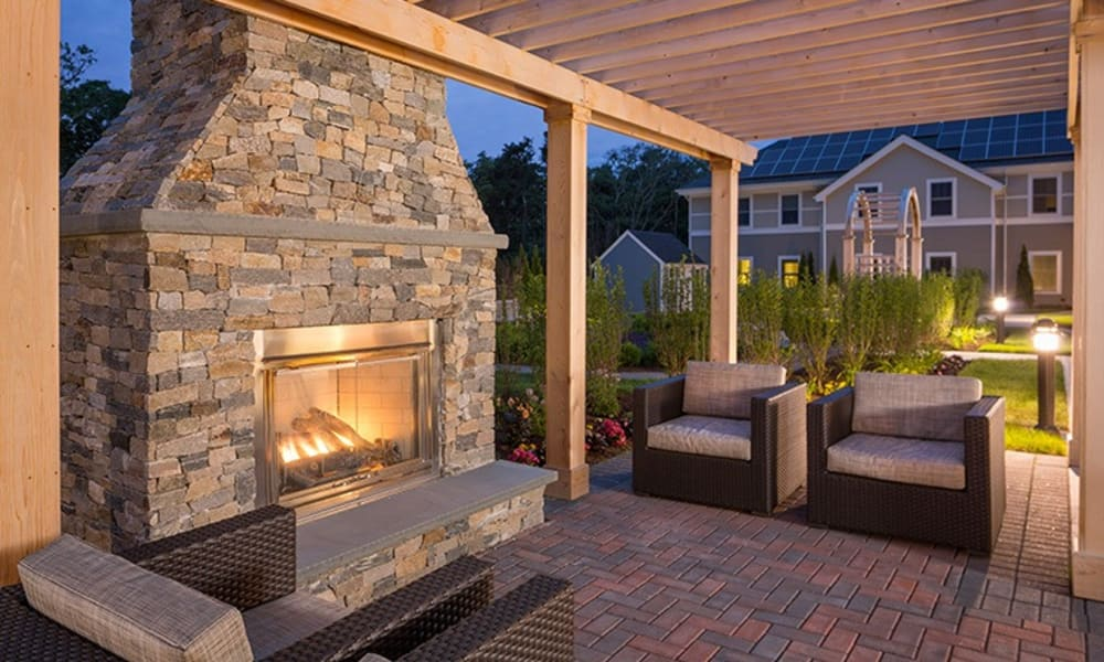 Outdoor fireplace at a Maplewood Senior Living community