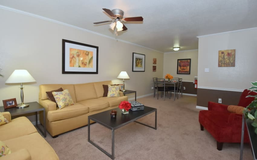 Spacious living room at Falls of Maplewood Apartments