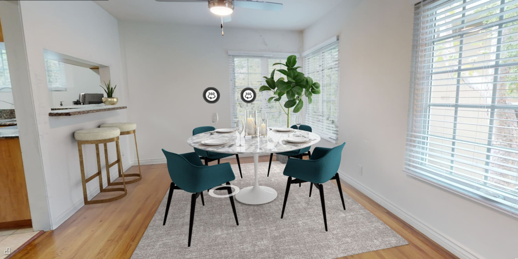 Well-furnished dining area in a model home at Sunset Barrington Gardens in Los Angeles, California