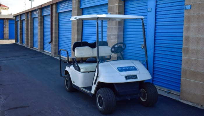 A golf cart in front of exterior storage units at STOR-N-LOCK Self Storage in West Valley City, Utah