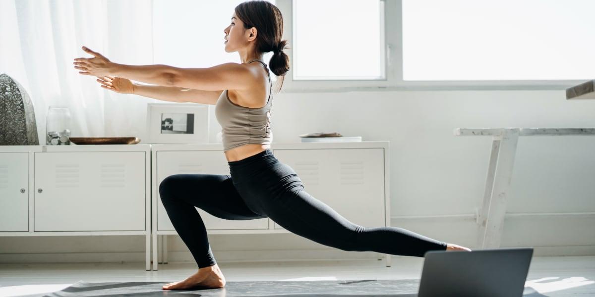 Resident exercising in her living room at Ashford Belmar in Lakewood, Colorado