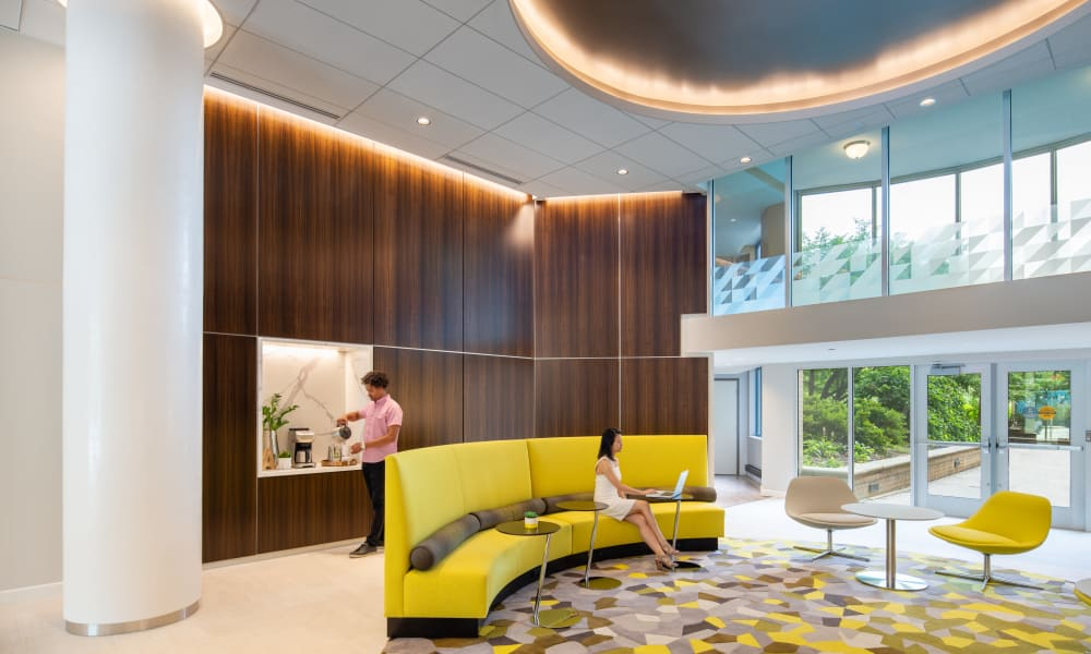 The lobby at Alexander House offers residents a library and lounge area in Silver Spring, Maryland