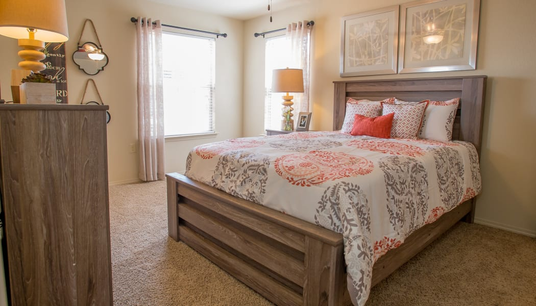 Bedroom with a ceiling fan at Mission Point Apartments in Moore, Oklahoma