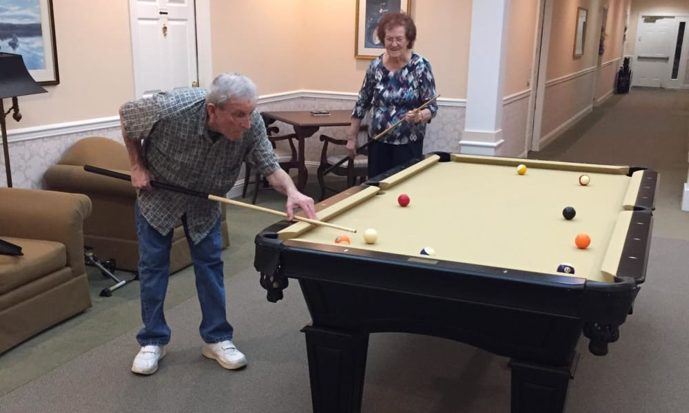 Senior man playing pool at Azalea Estates of Gonzales in Gonzales, LA