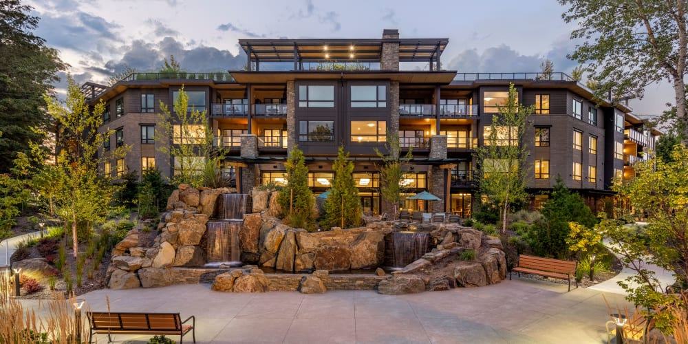 Inviting patio with a pond and lots of plantlife around at The Springs at Lake Oswego in Lake Oswego, Oregon