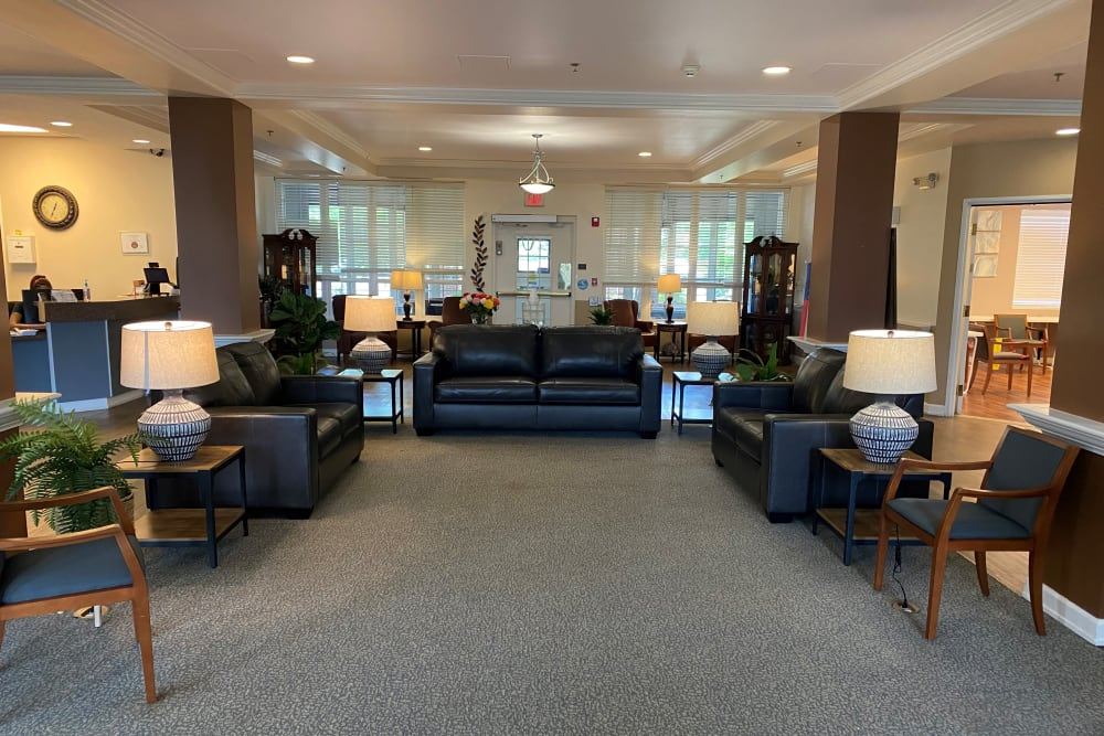 Elegant seating area with couches and lamps at Caley Ridge Assisted Living in Englewood, Colorado