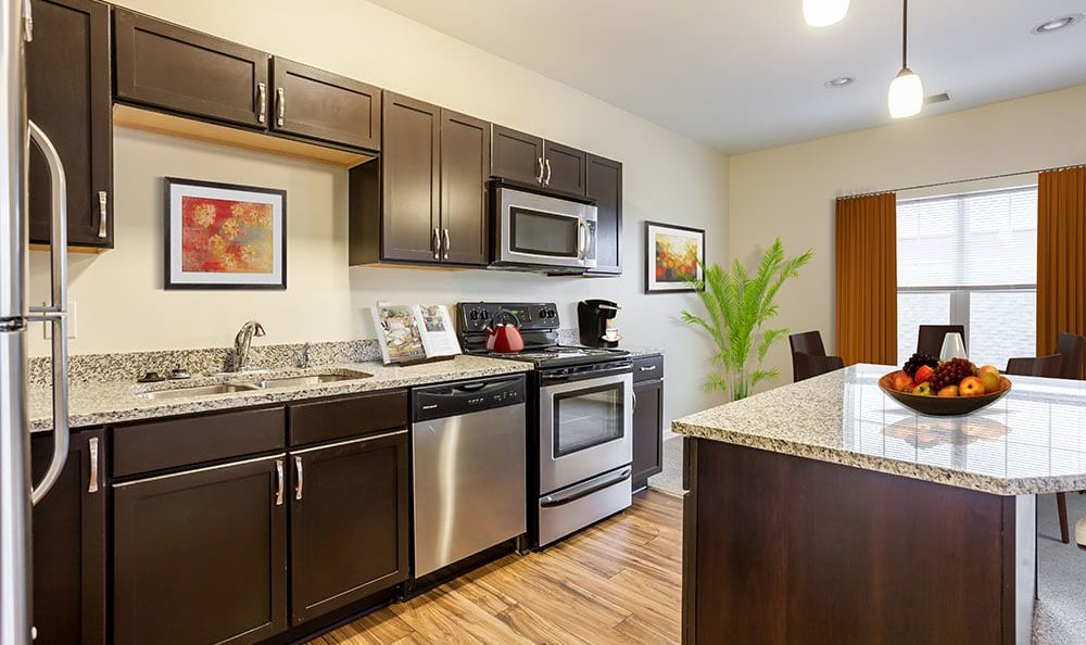 Fully equipped kitchen at Ethan Pointe Apartments home in Rochester, NY