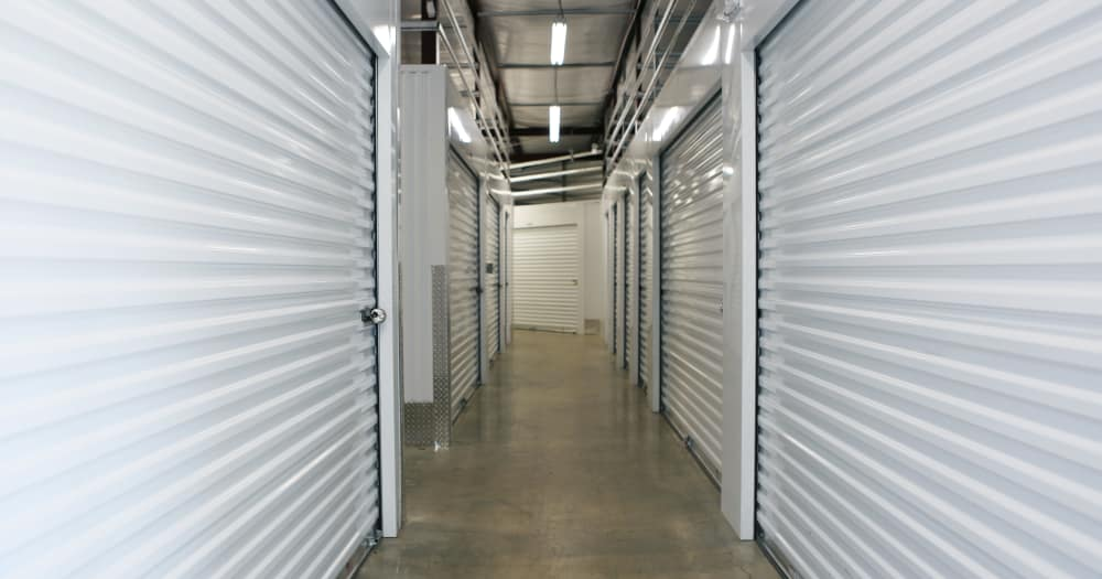 Storage units with white doors at Midgard Self Storage in Roswell, Georgia
