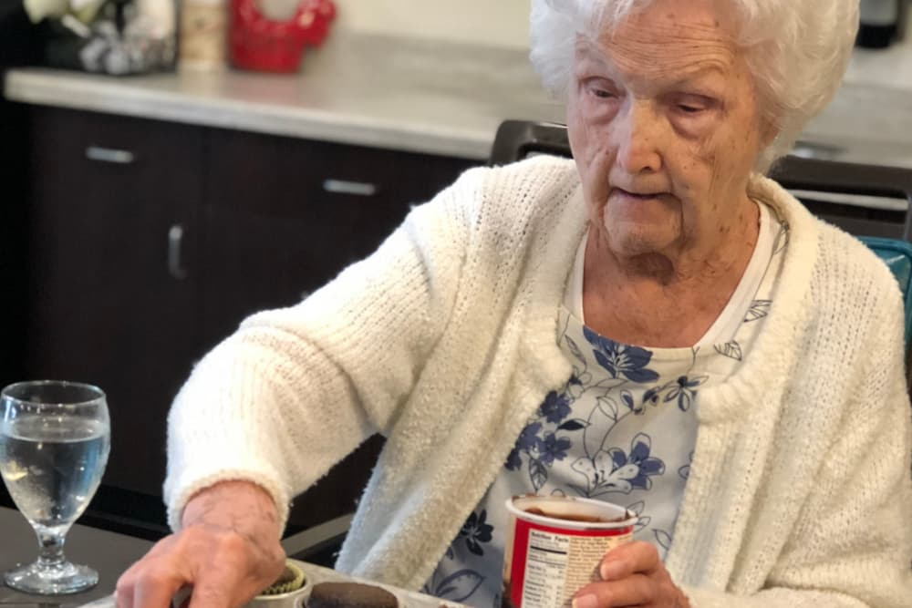Female resident baking cupcakes at Springview Manor in Lima, Ohio