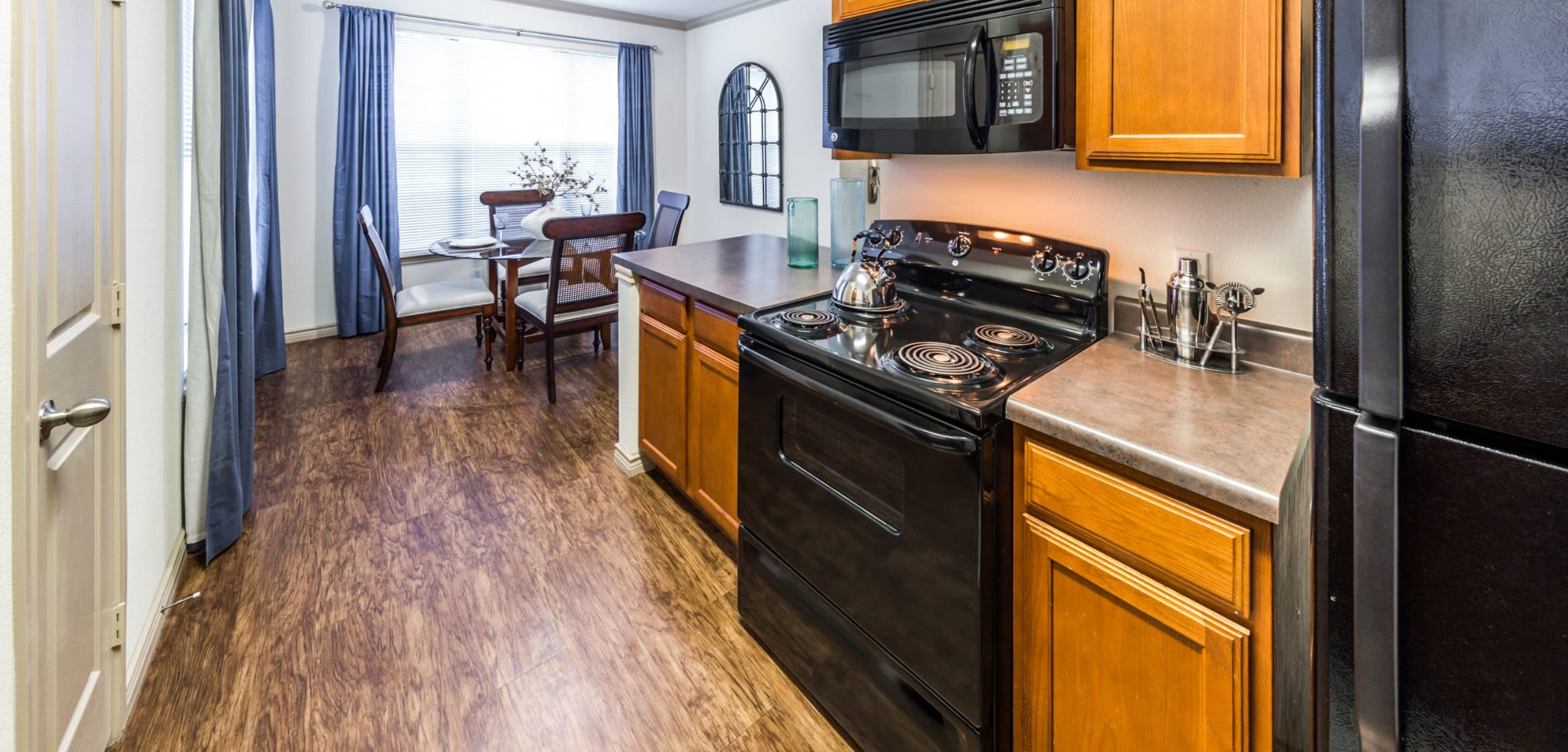 Kitchen with black appliances at The Marquis at Brushy Creek in Austin, Texas