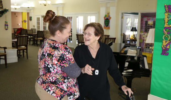 Senior woman receving attetion at Azalea Estates of Gonzales in Gonzales, LA
