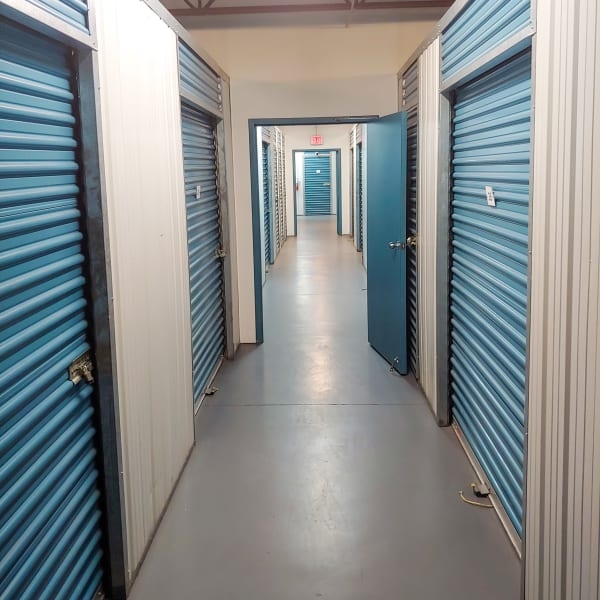 Indoor storage units with blue doors at StorQuest Express - Self Service Storage in Tampa, Florida