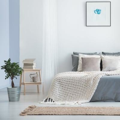 Minimalist decor in a model home's bedroom at Sofi Dublin in Dublin, California