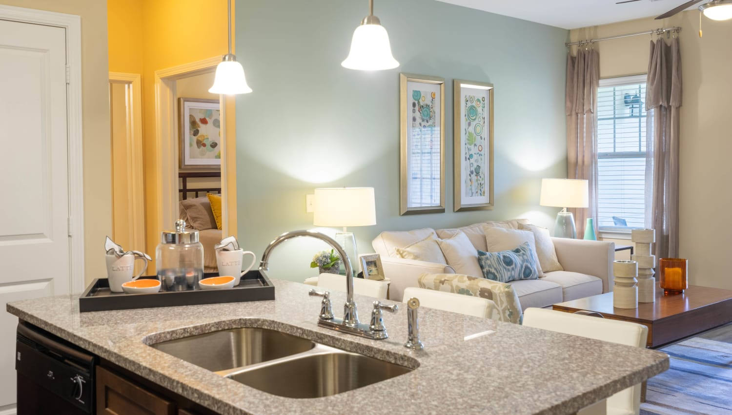 Granite countertop on the island in a model home's kitchen at Legends at White Oak in Ooltewah, Tennessee