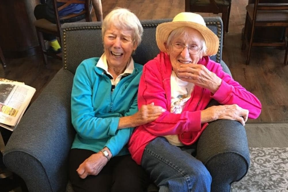 Two residents laughing joyously at The Landings of Kaukauna in Kaukauna, Wisconsin