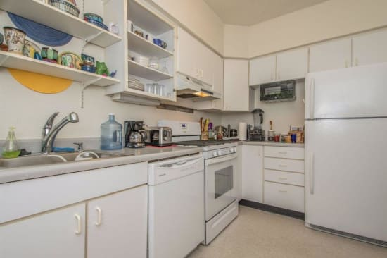 Kitchen with white appliances at Alta Casa in Des Moines, Iowa