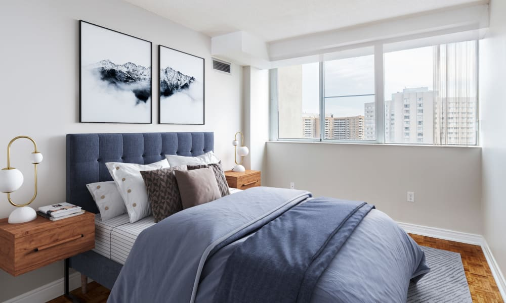Bedroom with modern decor at Mississauga Place in Mississauga, Ontario