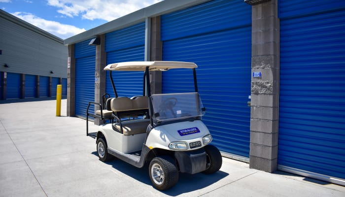 A golf cart in front of exterior storage units at STOR-N-LOCK Self Storage in Colorado Springs, Colorado