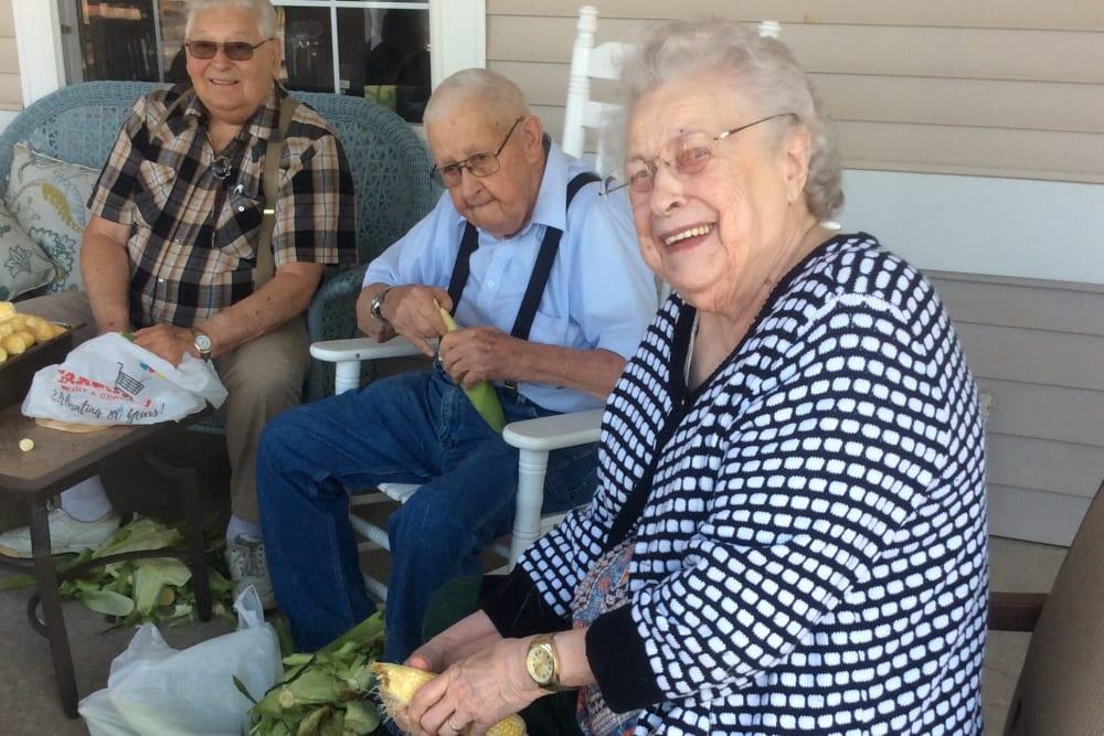 Residents preparing corn on the porch at Clover Ridge Place in Maquoketa, Iowa.