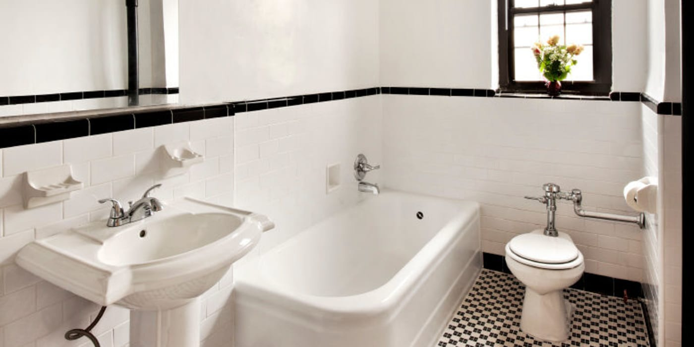 Large bathroom with a window at London Terrace Gardens in New York, New York