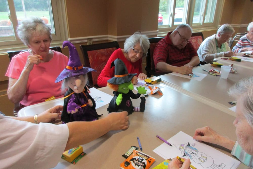 Residents coloring at The Woods of Caledonia in Racine, Wisconsin