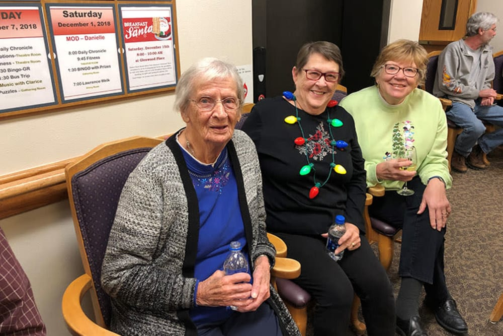 Residents sitting after a holiday celebration at Glenwood Place in Marshalltown, Iowa.