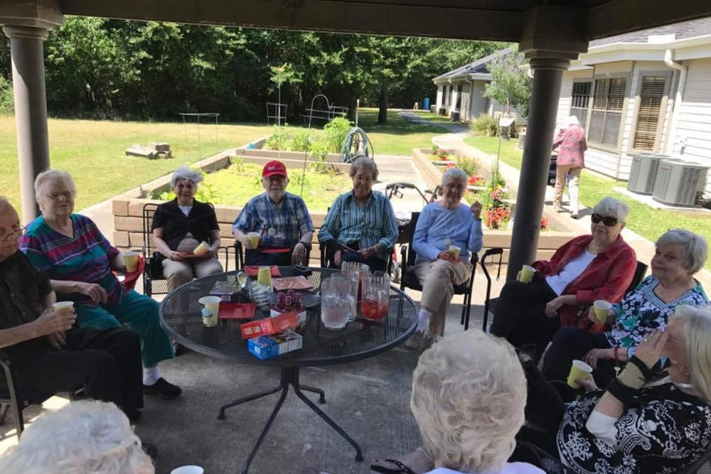 Residents gathered in the shade at Parsons House Cypress in Cypress, Texas