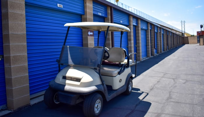 A golf cart in front of exterior storage units at STOR-N-LOCK Self Storage in Riverdale, Utah